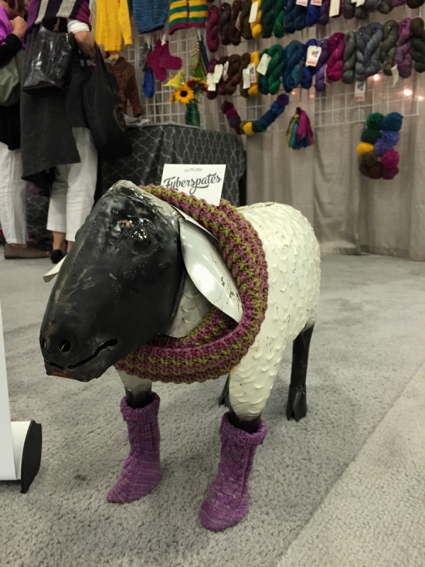At the Fyberspates booth. Metalwork sheep + wee hand knit socks? I'm in love.