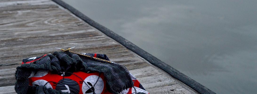 selfish knitting on the dock