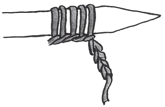 A series of stitches on a knitting needle, with a crochet chain coming down from one end.