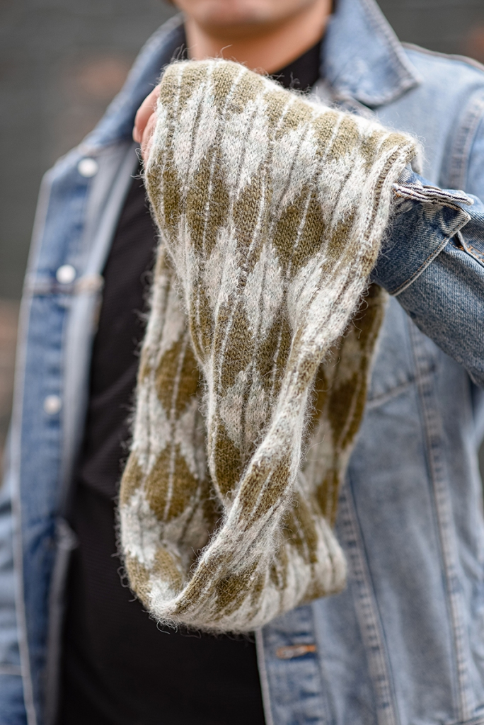 Close up of a hand-knit, stranded colourwork cowl.